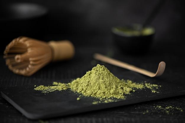 Green matcha powder on black board