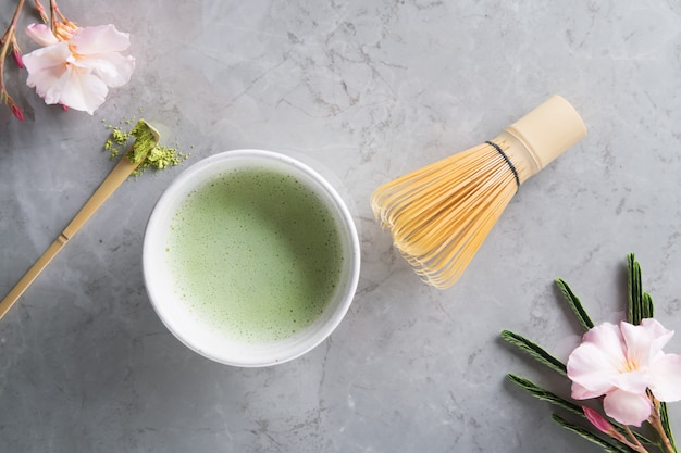 Green matcha tea drink and tea accessories