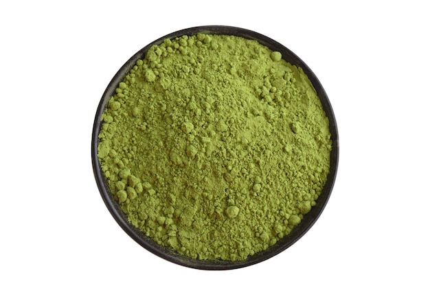 Green matcha tea powder in black bowl isolated on white