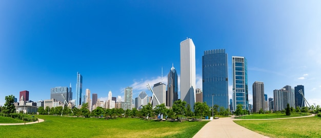 Green meadow on cityscape of chicago