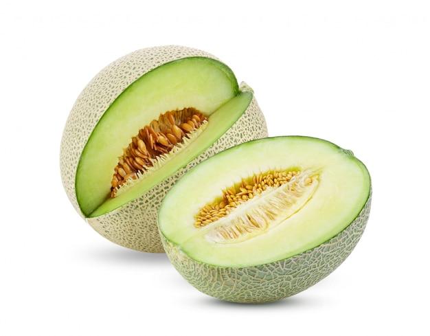 Green melon on white table.