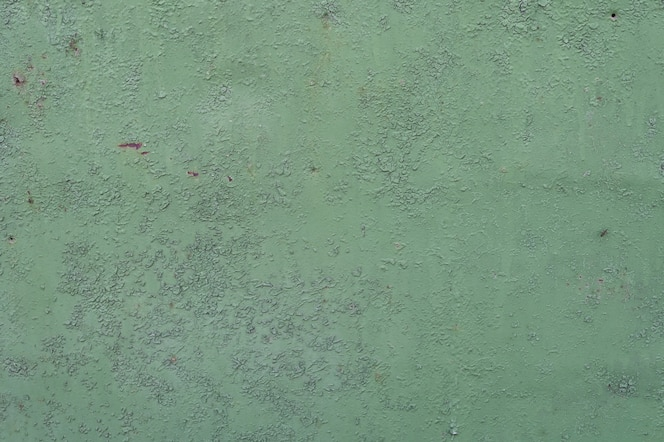 Green metal background. poured paint. metal texture can be used as background
