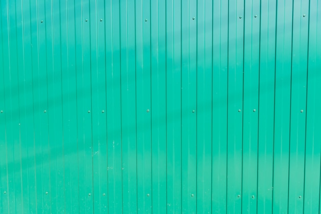 Green metal fence background, seamless texture