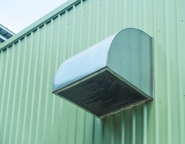 Green metal sheet siding of building and ventilate