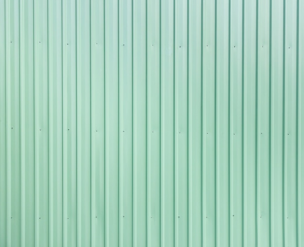Green metal sheet siding of building