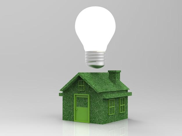 Зеленый макет дома с лампочкой