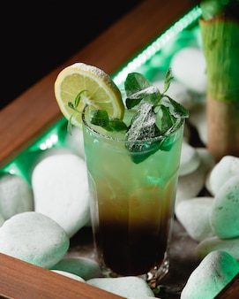 Green mojito with alcohol on table