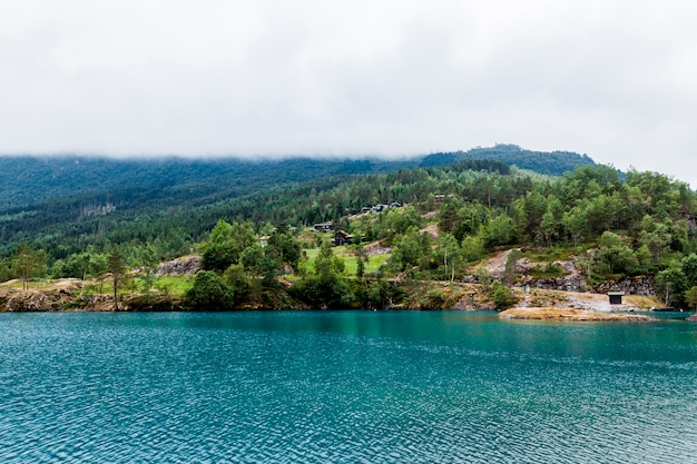 Green mountain landscape with blue idyllic lake