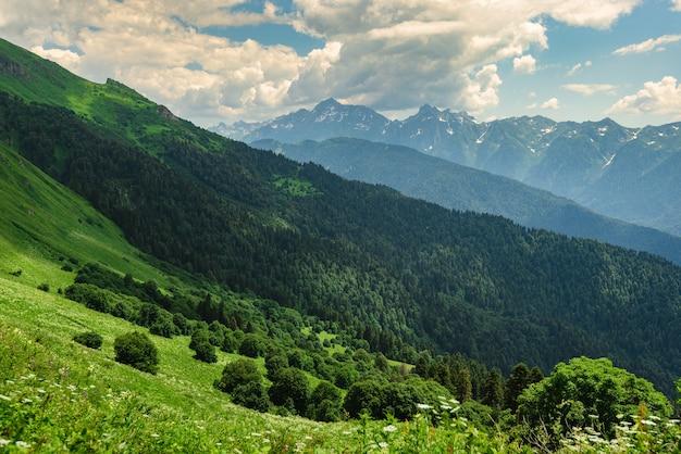 Green mountain peak. layers of mountains in the haze during sunset. krasnaya polyana, sochi, russia.