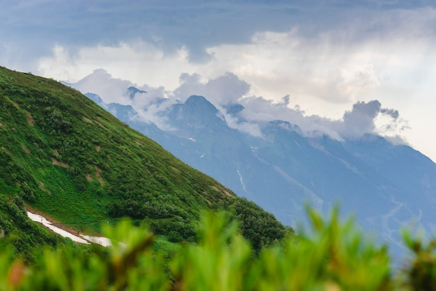Green mountain slope. layers of mountains in the haze during sunset. multilayered misty nountains