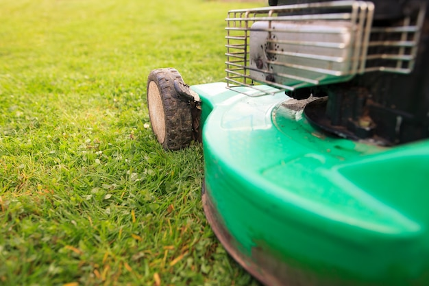 Green mower on the fresh spring grass
