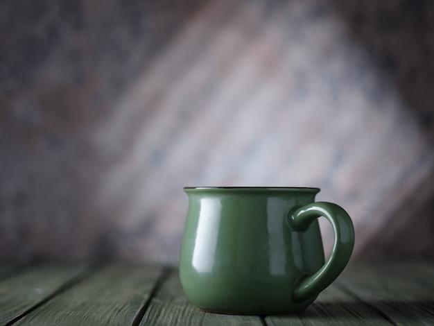Green mug on the table