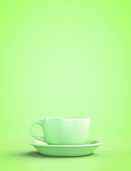 緑の背景に受け皿と緑のマグカップ。 copyspaceで。