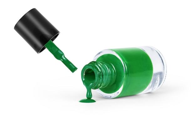 白い背景の上の緑のマニキュア