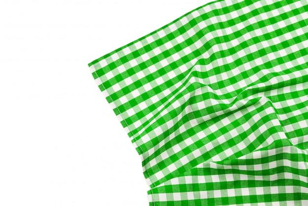 白い背景に分離された緑のナプキン。コピースペース。