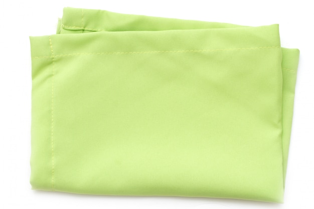 Green napkin on white surface isolated