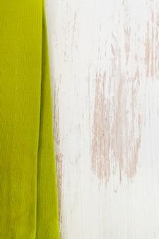 Green napkin on white wooden