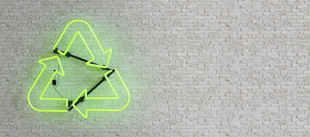 Green neon lamp with recycling symbol on white brick wall
