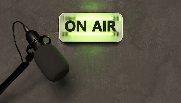 Green neon sign with the word on air and studio microphone under it