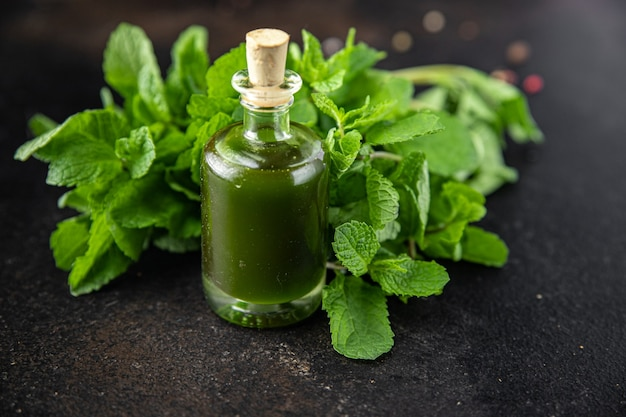 Green oil parsley dill basil fresh mint meal snack on the table copy space food background rustic