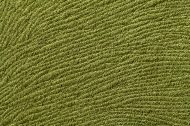 Green olive background from soft textile material, fabric with natural texture,