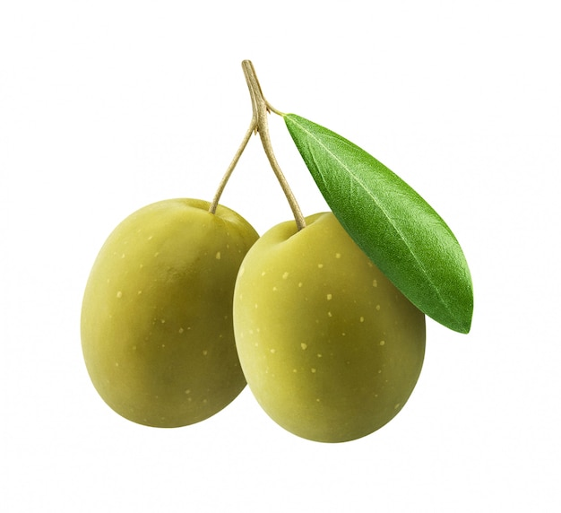 Green olives with leaves on white surface