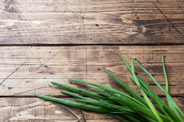 Green onions or shallots on a wooden background