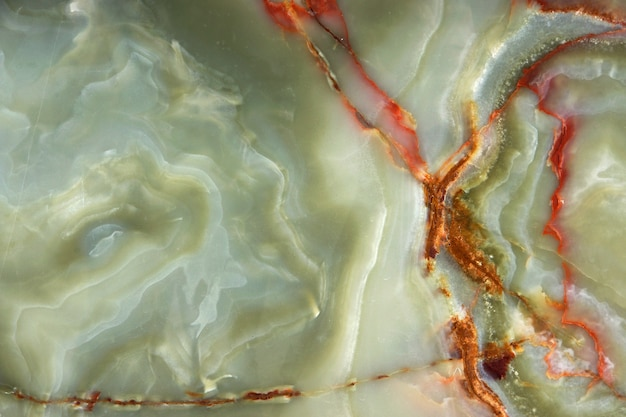 Green onyx with red veins, the surface of natural stone.