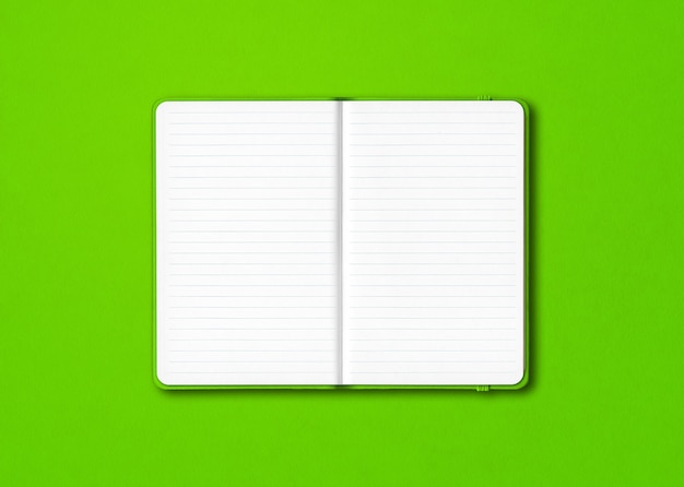 Green open lined notebook  isolated on colorful background