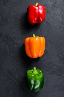 Green, orange and red bell peppers.