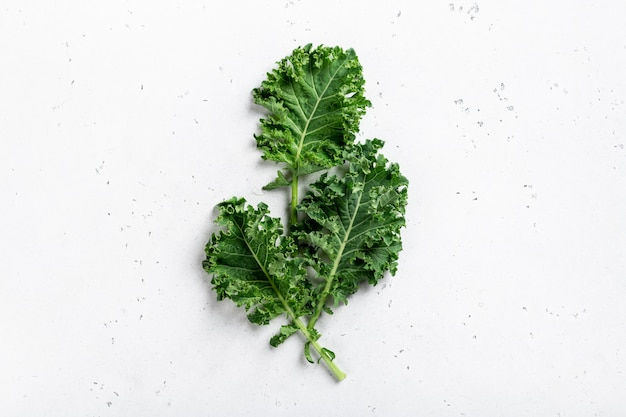 Green organic kale leaf isolated on white