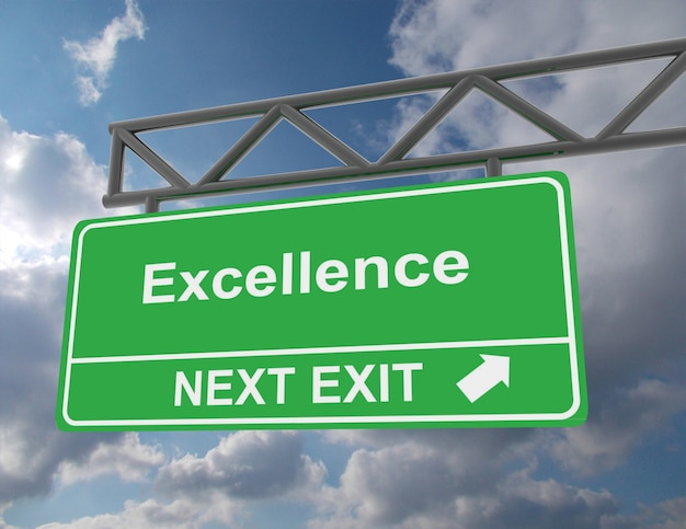 Green overhead road sign with an excellence