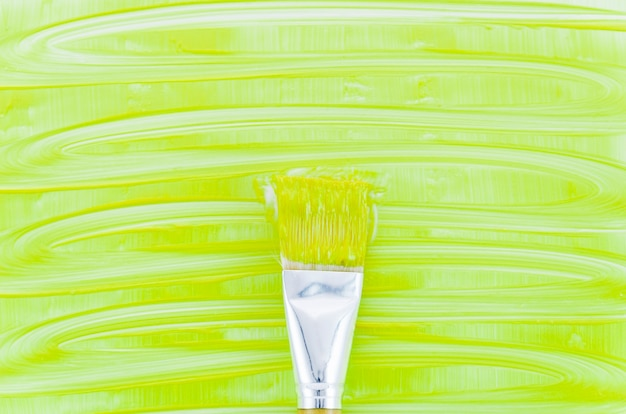 Green paint background with brush