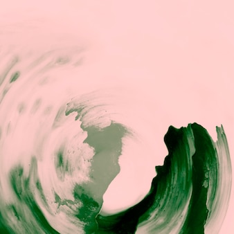 Green paint brush strokes over peach background