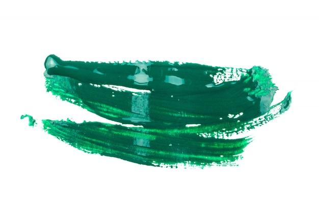 白い背景の上の緑色の塗料