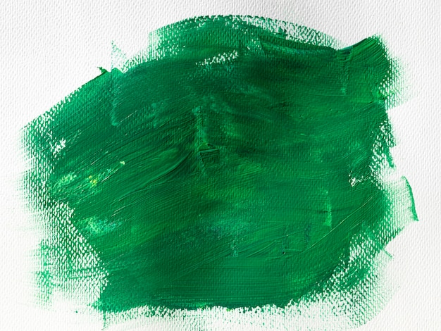 Green paint on white canvas