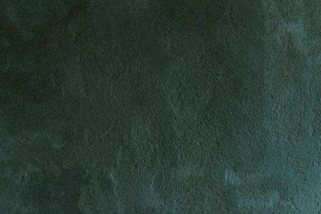 Зеленая окрашенная бетонная стена в стиле лофт текстуры фона