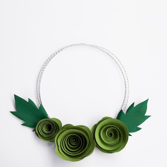 Green paper flowers frame on white background