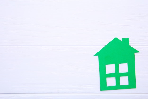 Green paper house on a white background