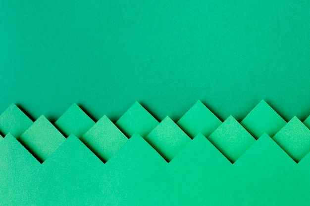 Green paper shapes background design