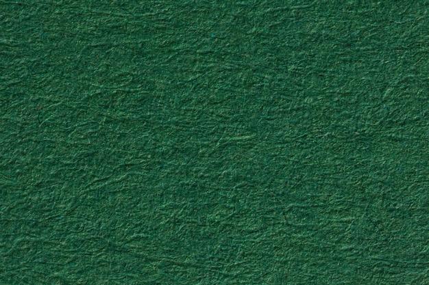 Предпосылка текстуры зеленой бумаги. фотография высокого разрешения.