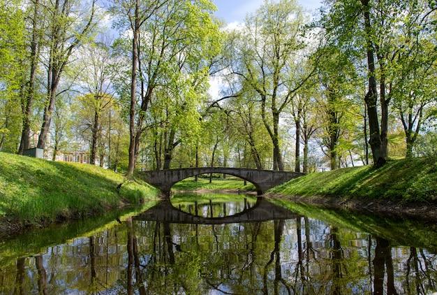 Green park and old bridge. scenic landscape.
