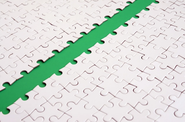 The green path is laid on the platform of a white folded jigsaw