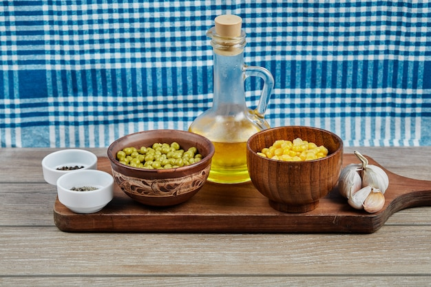 Green pea and corn beans in wooden cups.