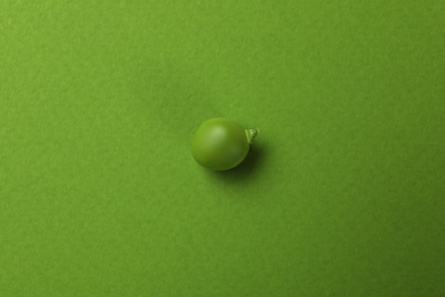 Green pea seed on green, close up