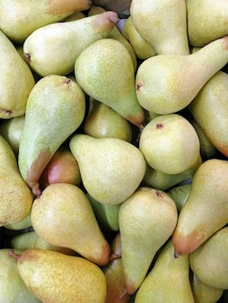 A green pear in large numbers fills the entire frame top view