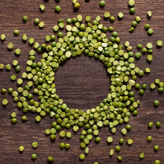 Green peas beautifully laid out on a wooden background. top view. copy space.. vegetarian food.