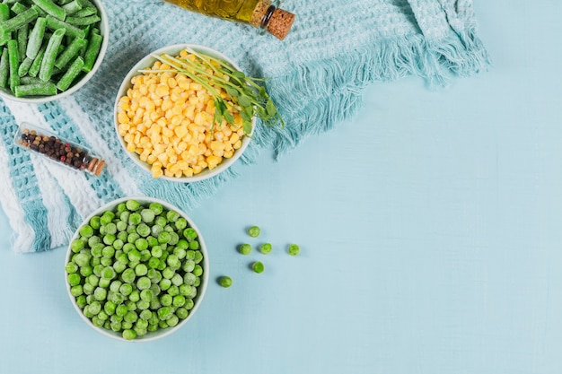Green peas sweet corn cut green beans in bowl concept of homemade preparations for fast cooking