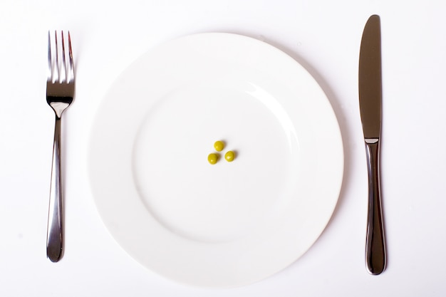 Green peas on white plate
