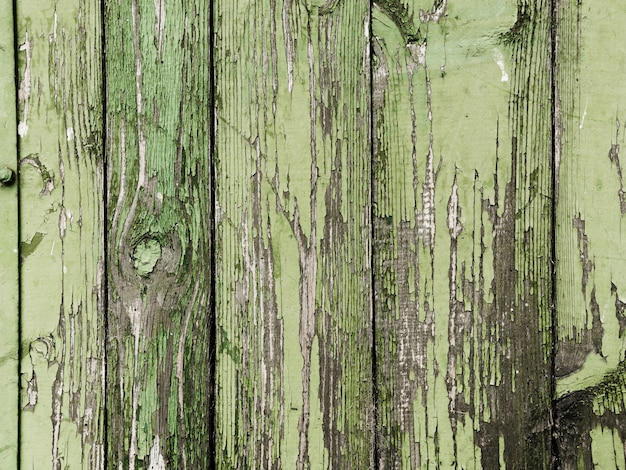 Green peeled paint of wooden plank texture